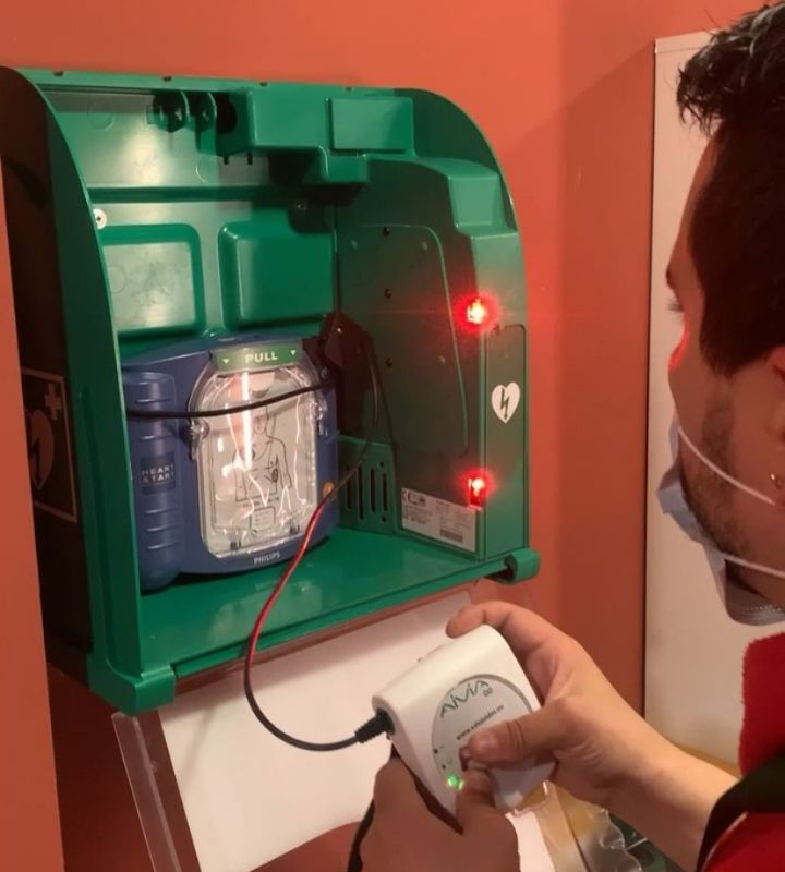 Installing the AED defibrillator in the display case